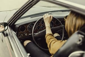 woman driving clean classic car