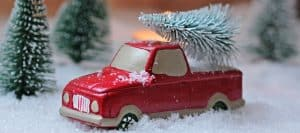 Toy Truck surrounded by fake snow and miniature Christmas trees