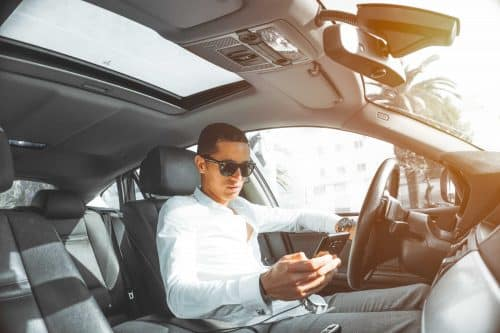 Man sitting in car with clean, new windshield