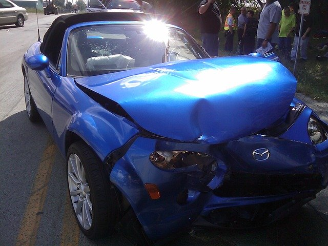 Blue convertible with damaged front end