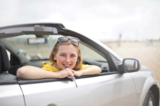 Woman leaning out of convertible window